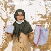 I., from Syria, shows a wallet and a bag she made out of an old shirt, as part of the Circular Fashion Workshop, which took place on the 26, 28 and 30th of July 2021 in Lisbon, Portugal.